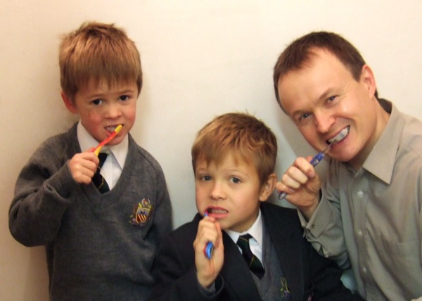Christopher John Payne with boys brushing teeth