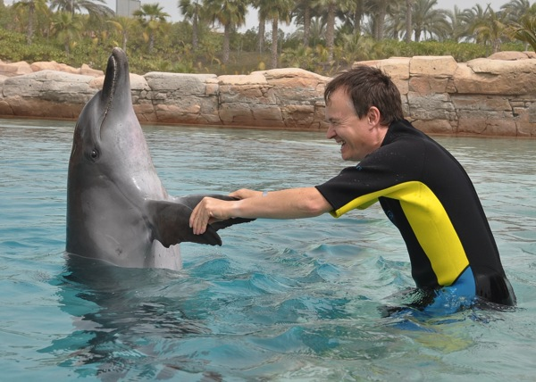 Christopher-John-Payne-with-dolphin-Atlantis-Hotel-Dubai