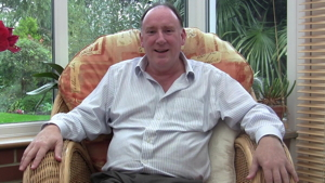 Martin Avis relaxing in his conservatory